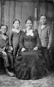 Ane Marie Madsen Johnson with her younger children, twins Jacob and Ephraim and daughter Agnes